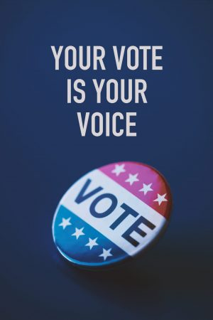 closeup of a vote badge for the United States election on a blue background and the text your vote is your voice